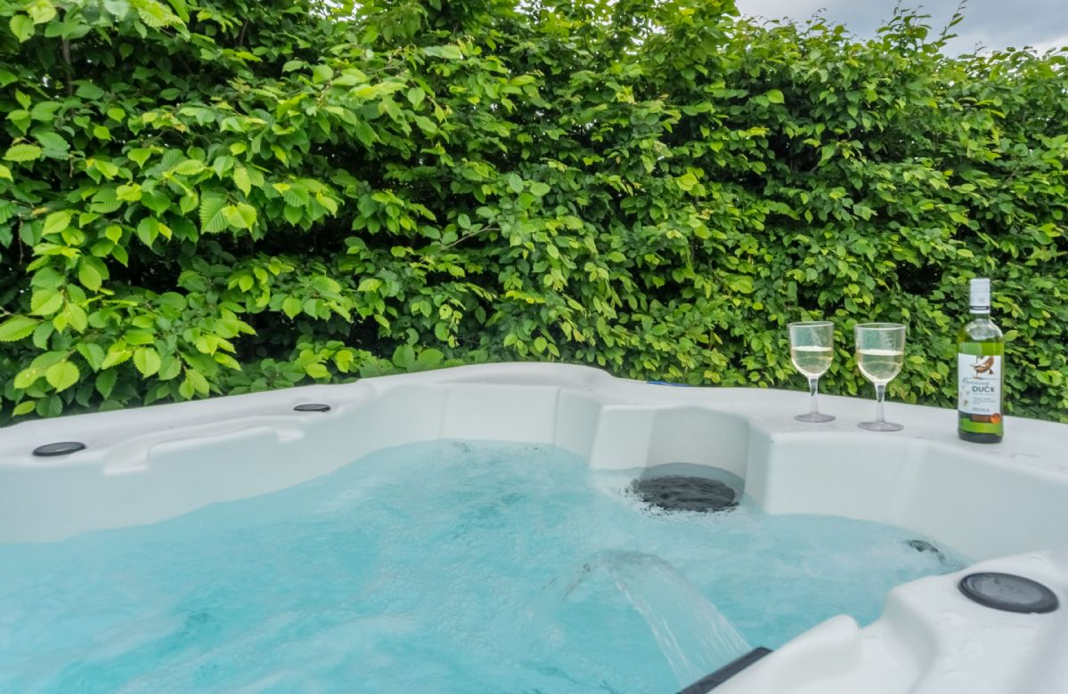 Enjoy a private hot tub exclusive to Willow Yurt