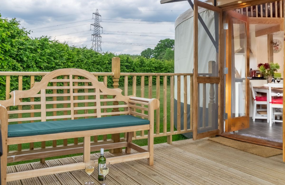 Watch the sunset from the charming bench outside Willow Yurt