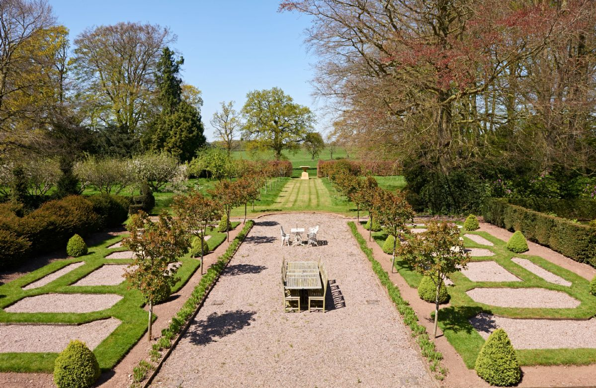 The formal landscaped gardens with seating