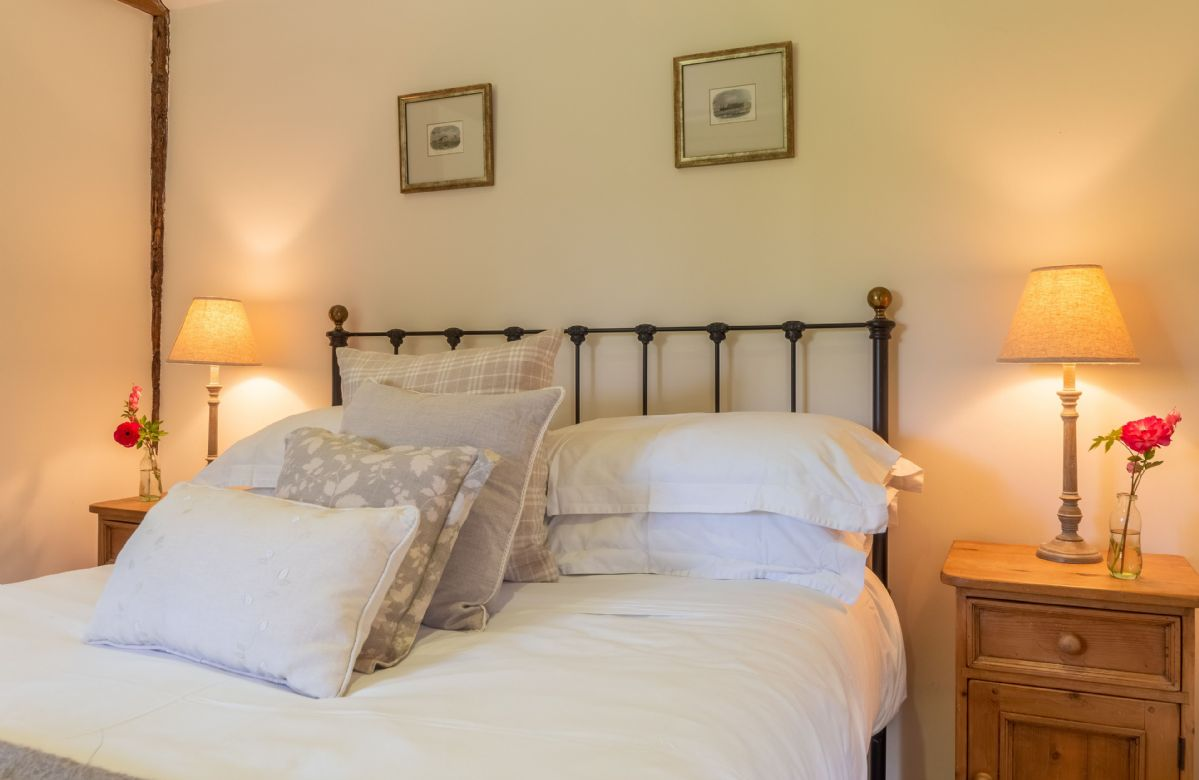 Ground floor: Charming double bedroom with beautiful cast iron bed and plenty of comfortable pillows