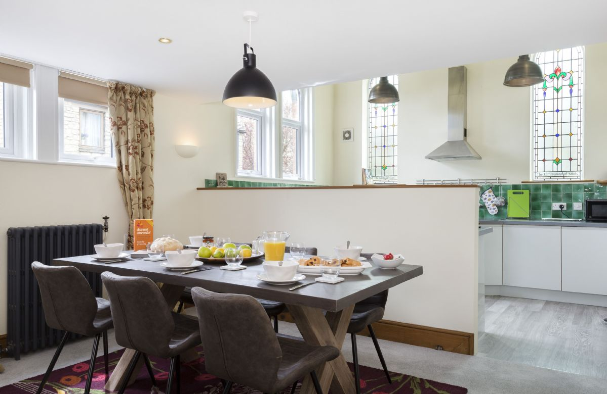 Ground floor: Dining table and chairs seating six guests