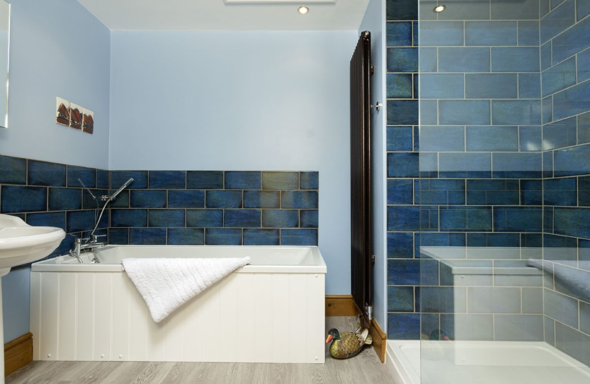 First floor: Family bathroom with bath and separate shower cubicle