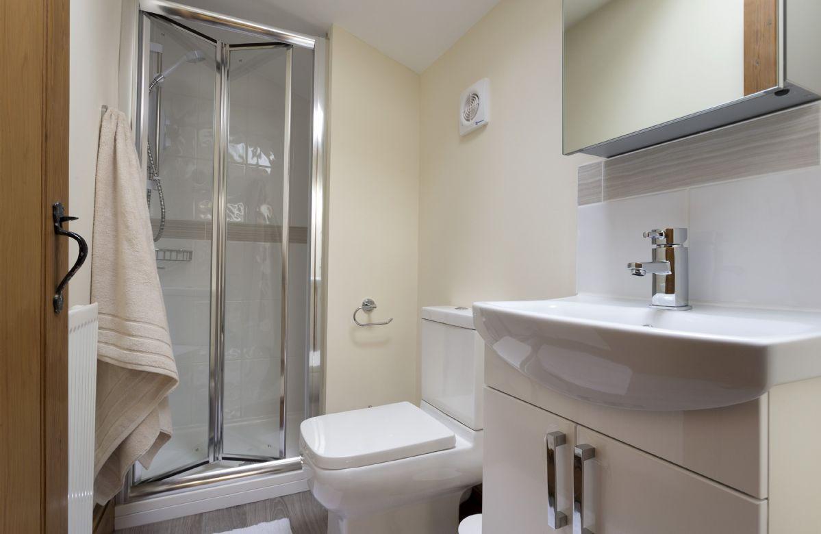 First floor: En-suite shower room to the master bedroom