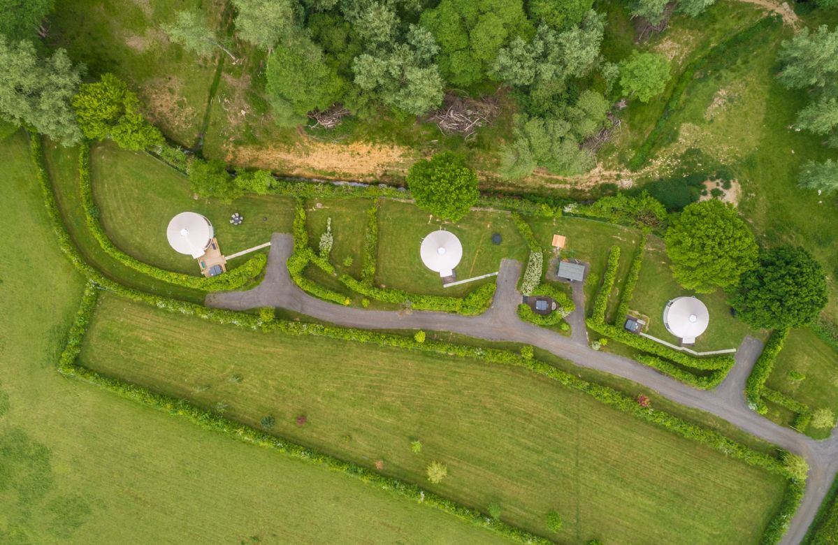 Aerial view of the three private yurts on this beautiful landscape