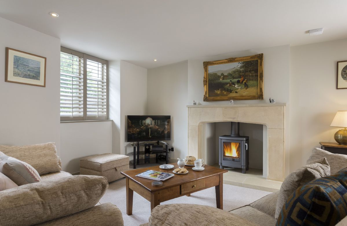 Ground floor: Relaxing and comfortable sitting room with a cosy wood burning stove