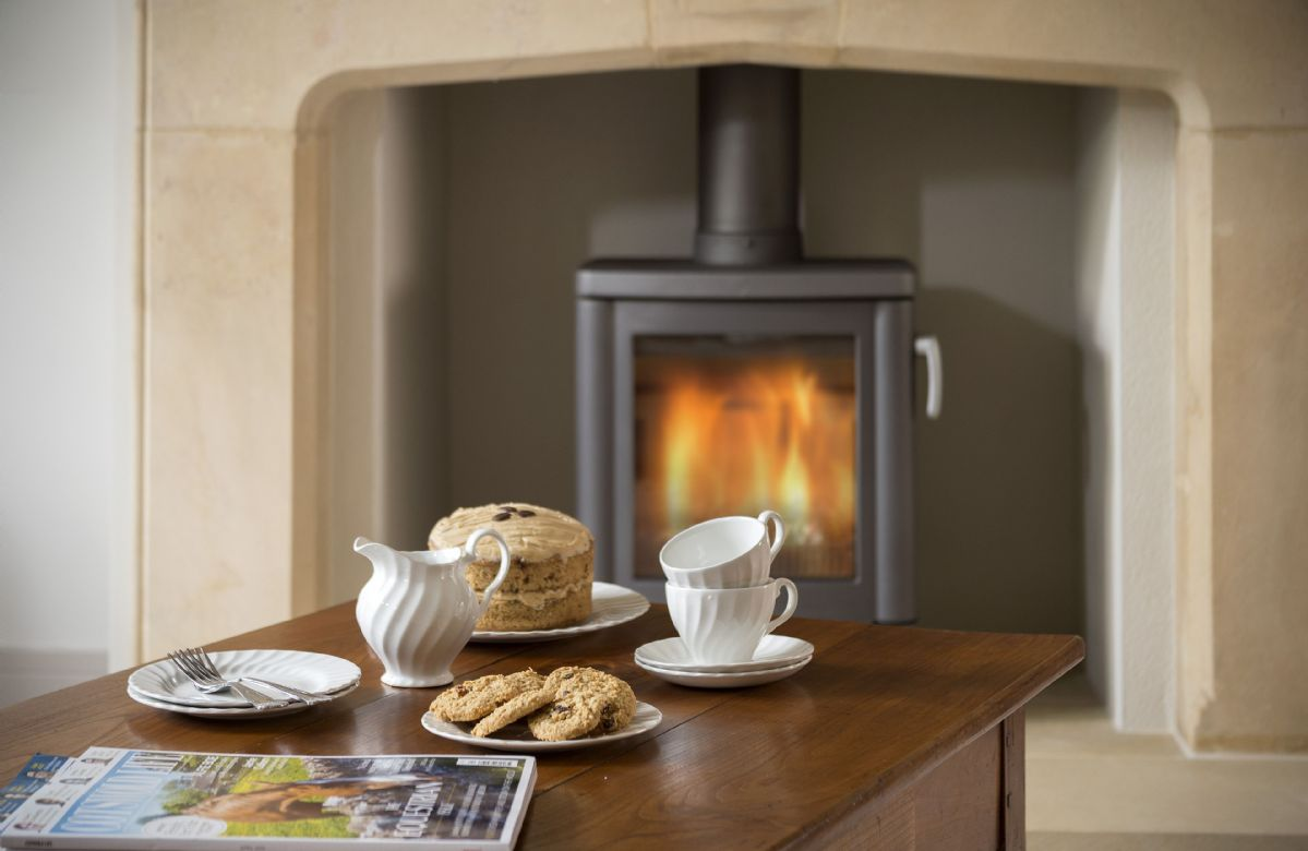 The cosy wood burning stove in the sitting room