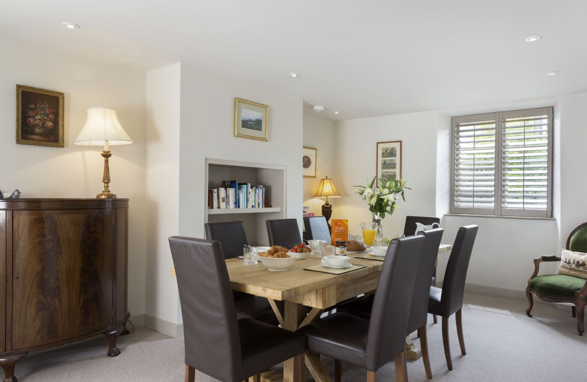 Ground floor: Open plan dining area with a large dining table seating eight guests