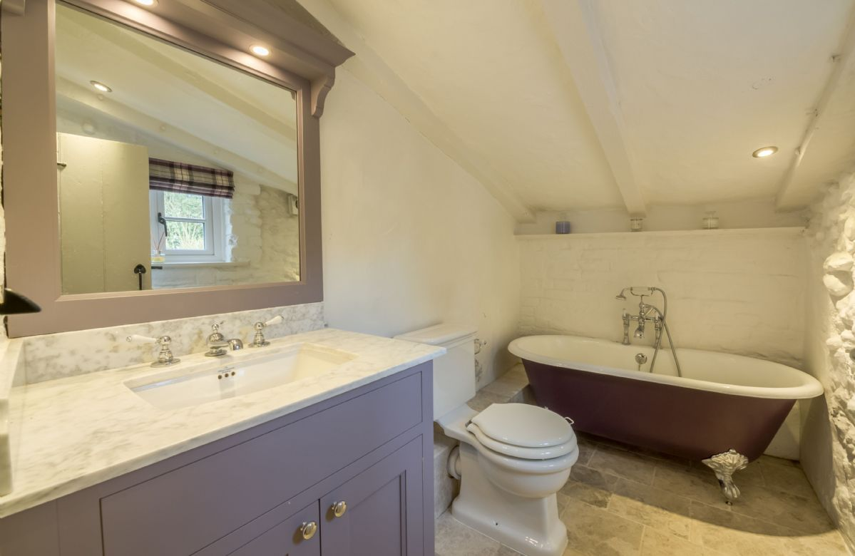 Ground floor: Bathroom with free standing double ended bath and handheld shower attachment