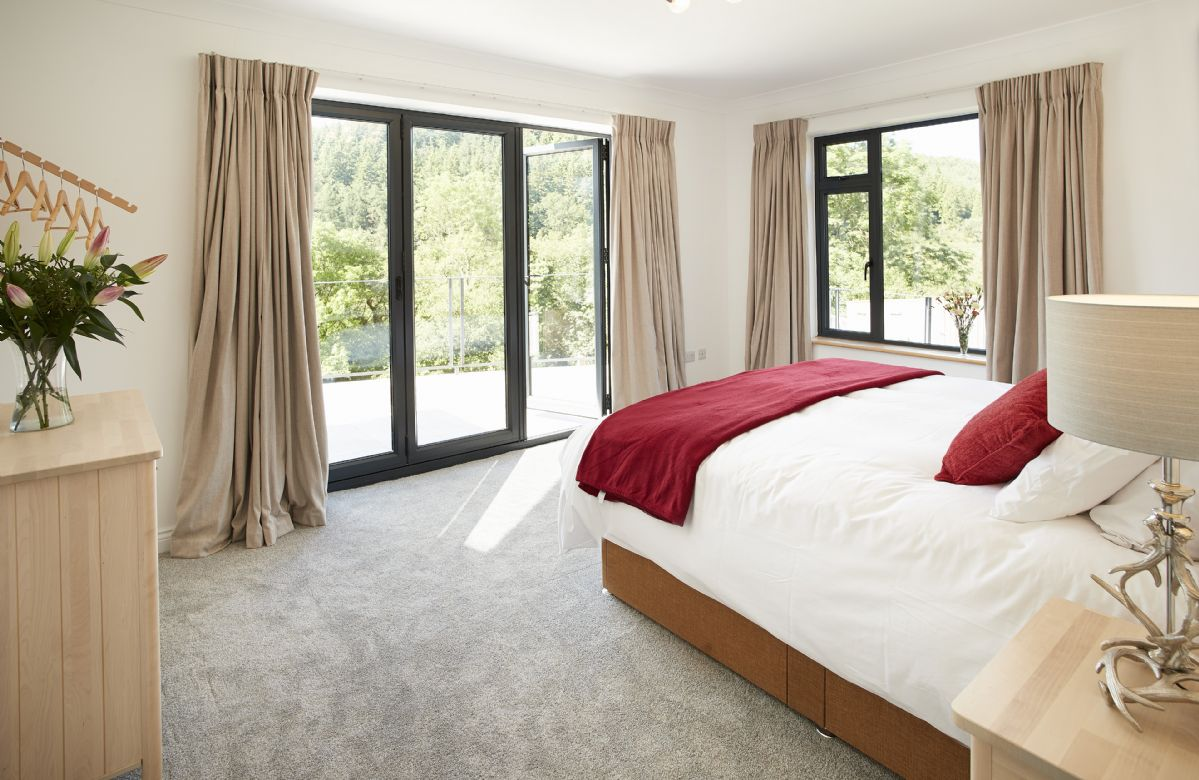 Ground floor: King size bedroom with en-suite shower and and bi-fold doors onto stunning views