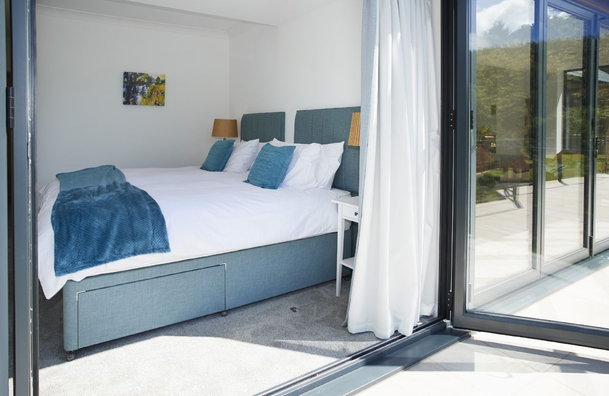 Ground floor: Super king size bed with en-suite and bi-fold doors onto stunning views