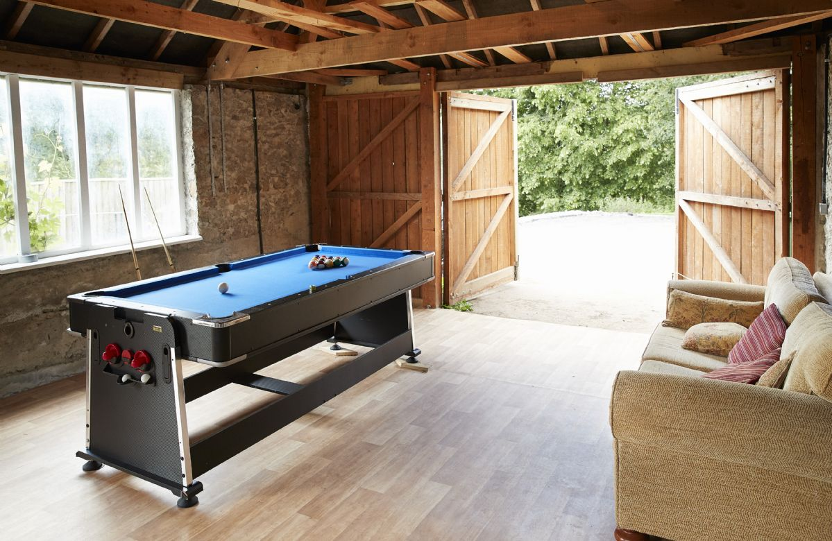 Games room with fridge, pool table, dart board (please bring your own darts), television and comfy chairs