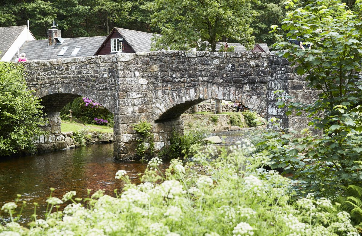 Fingle Bridge is a calm spot over the River Teign with unspoilt woods