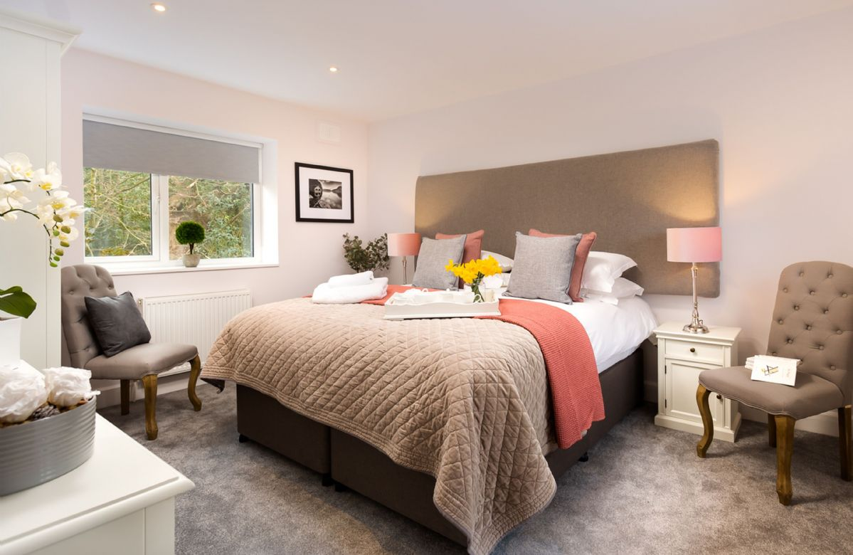 First floor: Double bedroom with super king size zip and link bed and en-suite with corner bath