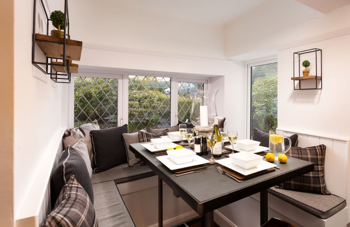 Ground floor: The bespoke slate topped dining table set into the bay window