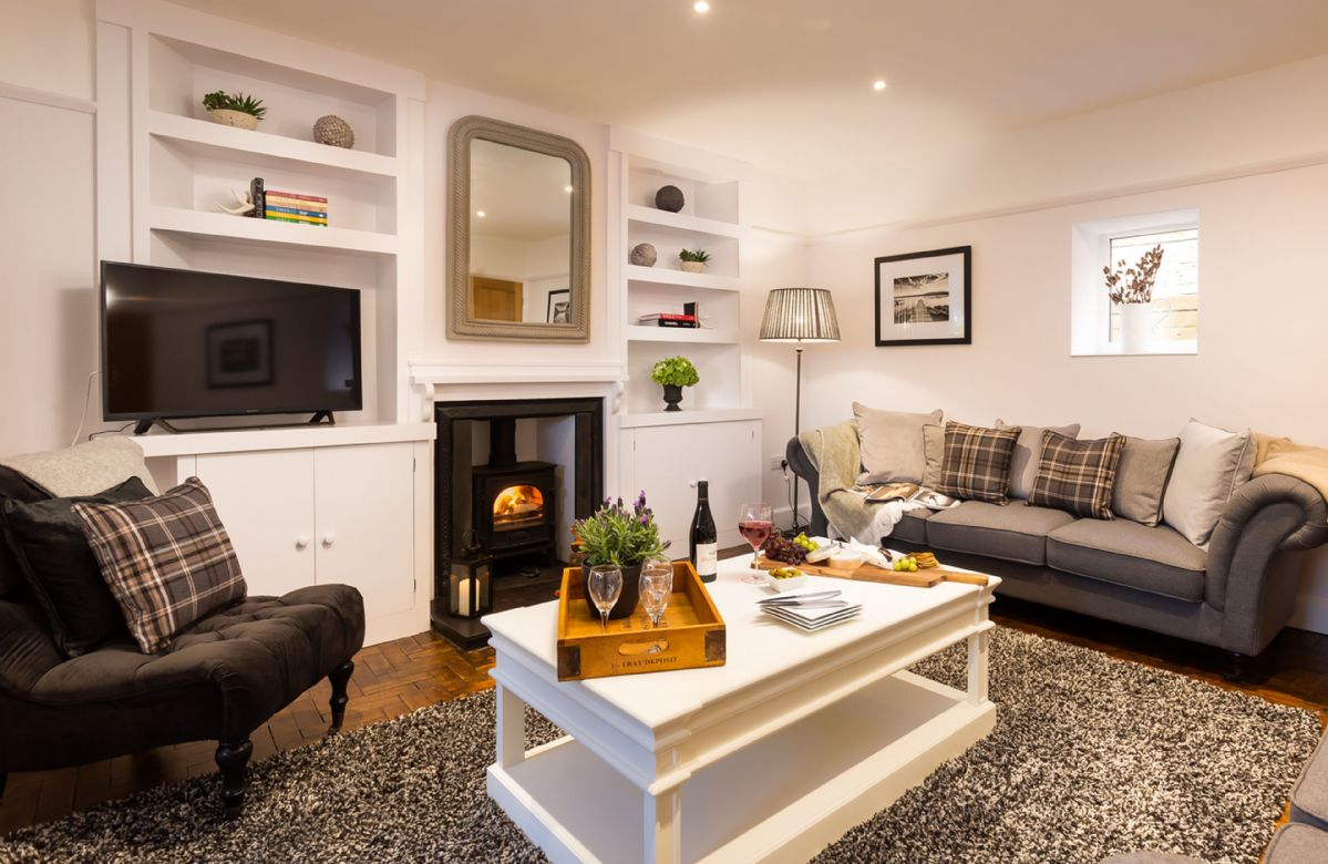 Ground floor: The spacious sitting room with wood burning stove