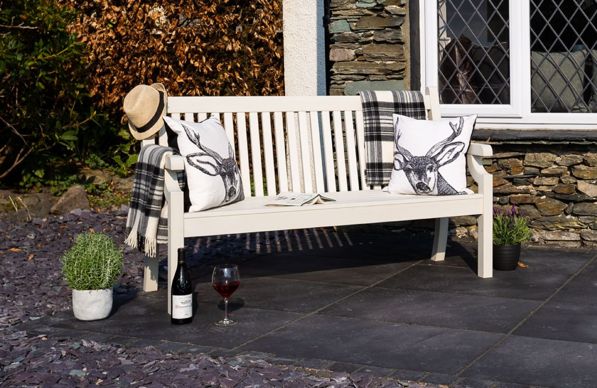 Enjoy the sunshine on the outdoor bench at the front of the property