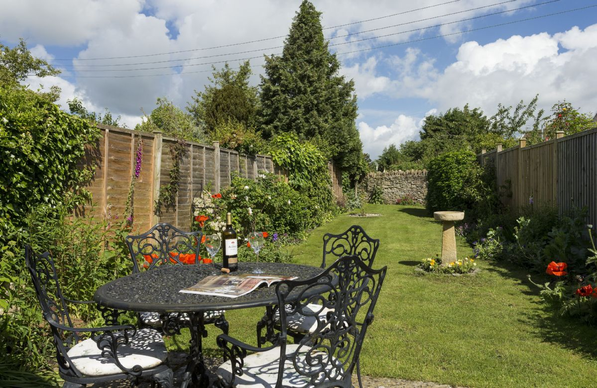 Large enclosed pretty rear garden with garden furniture