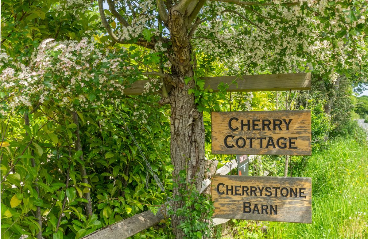 Welcoming signage at Cherry Cottage and Cherrystone Barn