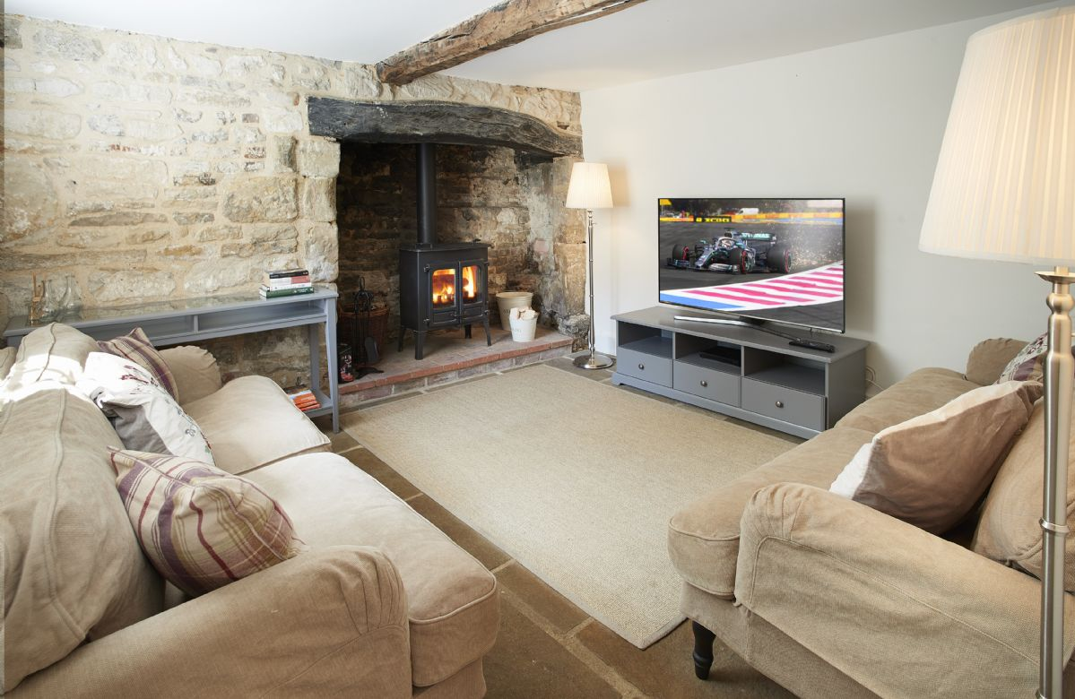 Ground floor: Cosy snug room with wood burning stove