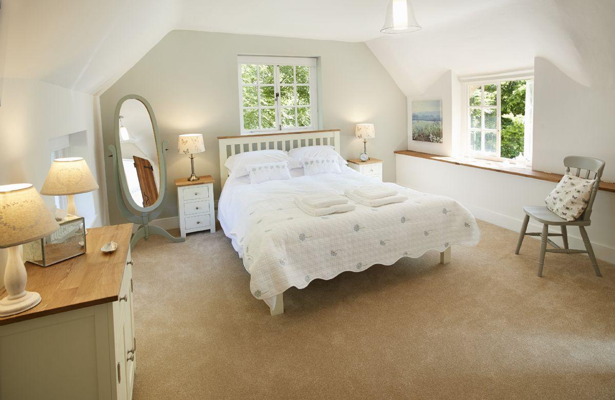 First floor: King size bedroom with en-suite shower room