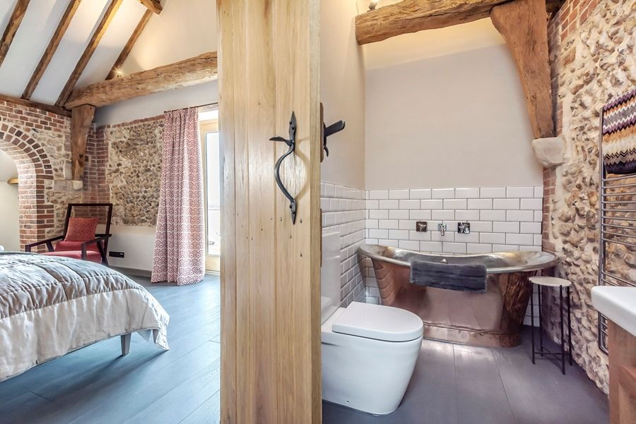 Beacon Hill Barn | Bedroom 1 with copper bath