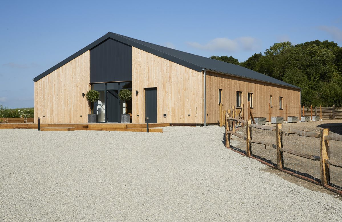 Bokes Barn is a contemporary barn conversion overlooking 80 acres of vineyards, in an Area of Outstanding Natural Beauty
