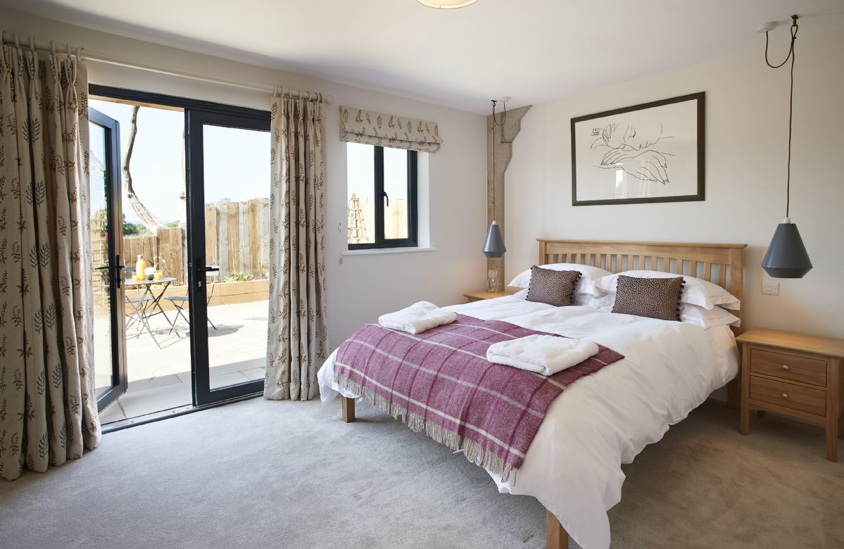 Ground floor: Bedroom with king-size bed, en-suite shower room and French doors leading to the terrace