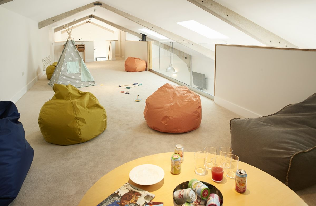 Mezzanine floor: large, open plan area for relaxation, with bean bags and projector screen