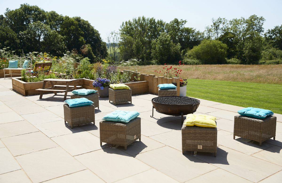 On the terrace is plenty of ratten furniture as well as a fire pit and barbecue