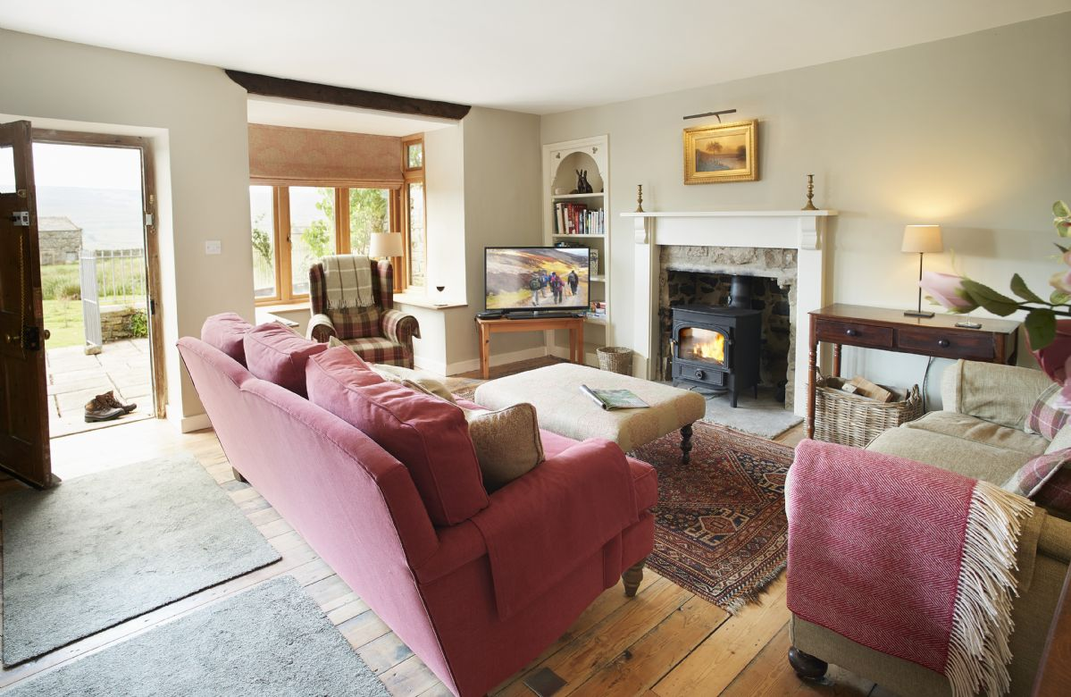 Ground floor: Spacious sitting room with log burning stove and underfloor heating