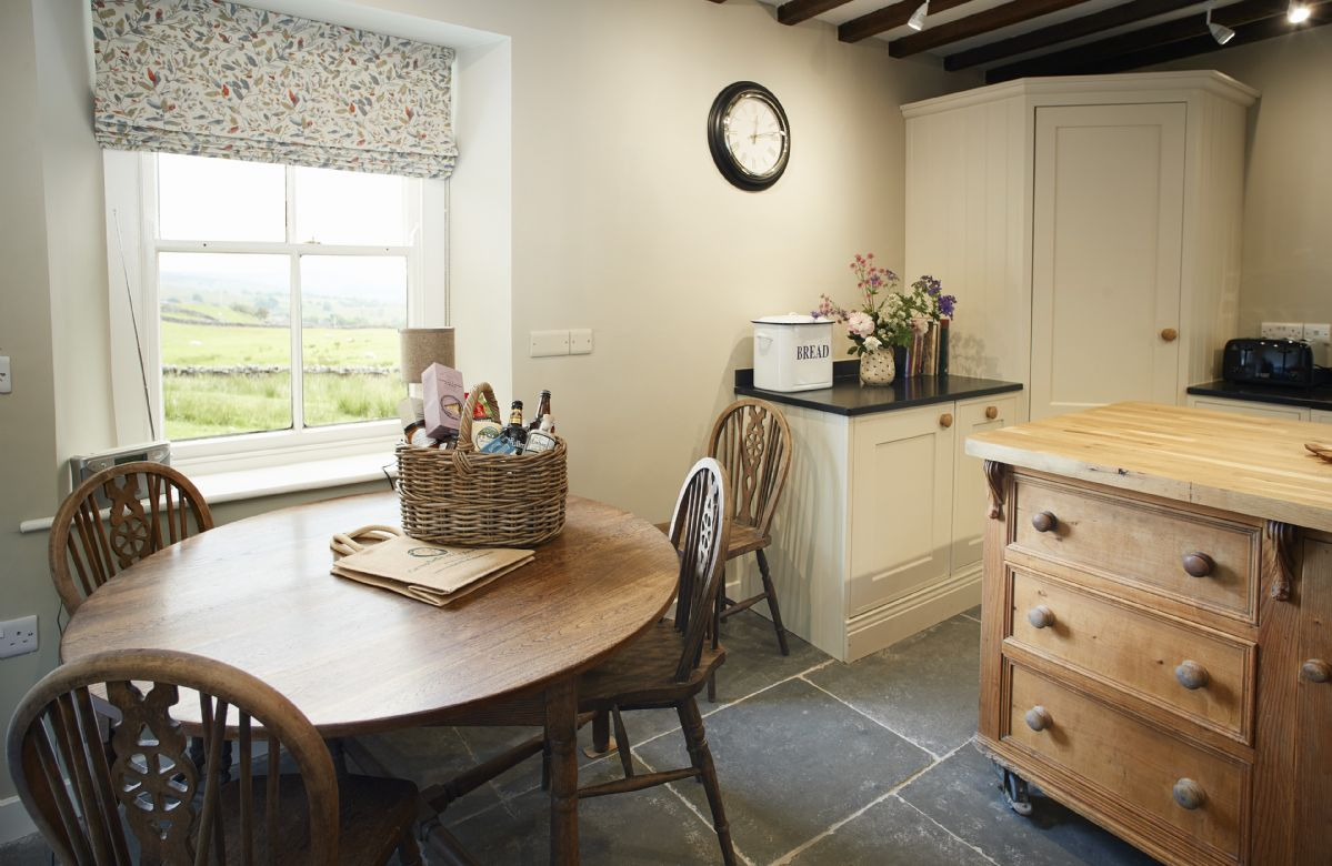 Ground floor: Kitchen table and chairs overlooking the beautiful countryside