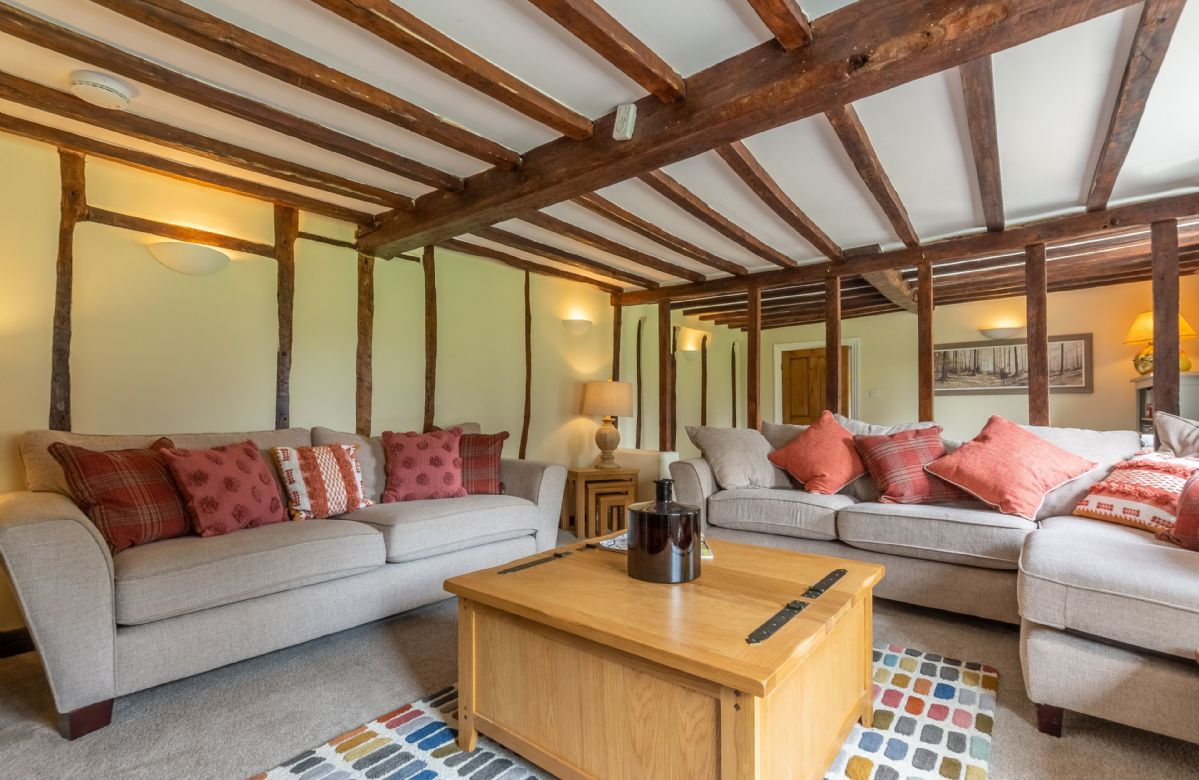 Ground floor: Sitting room with wood burning stove and original beams
