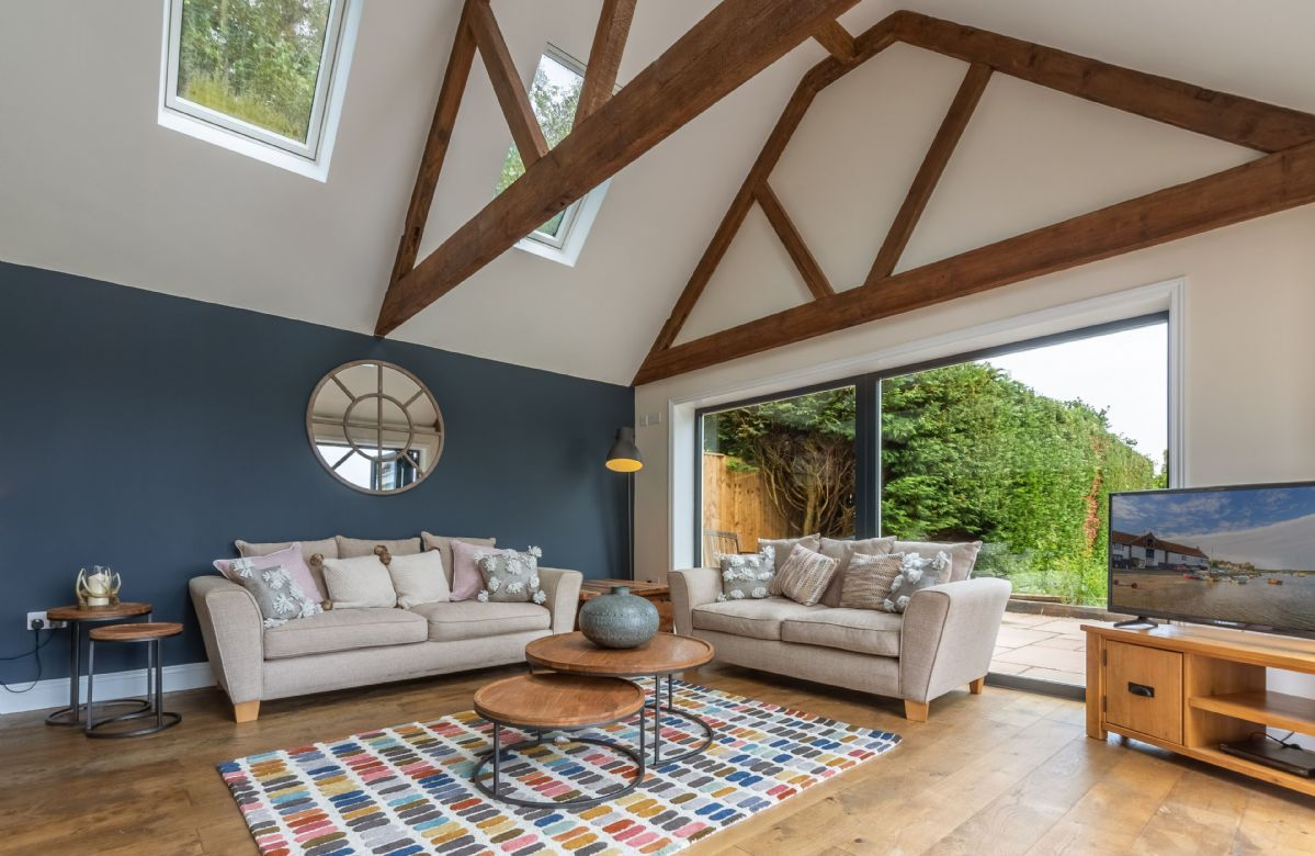 Ground floor: Comfortable seating area with stunning bi fold doors to the patio and garden