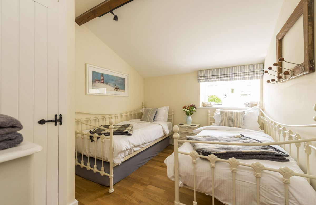 Ground floor: Bedroom three with twin day beds