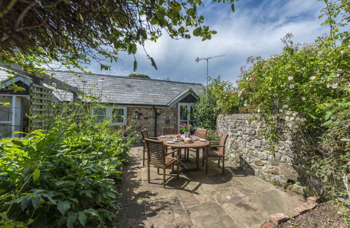 Bay Cottage has a pretty, private patio and garden