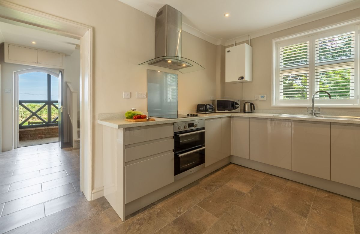 Ground floor: Spacious kitchen with an electric oven and hob