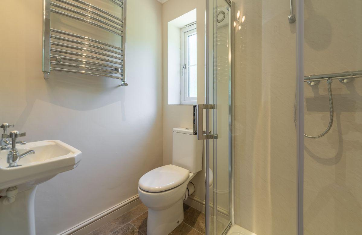 Ground floor: Shower room adjacent to the bedroom