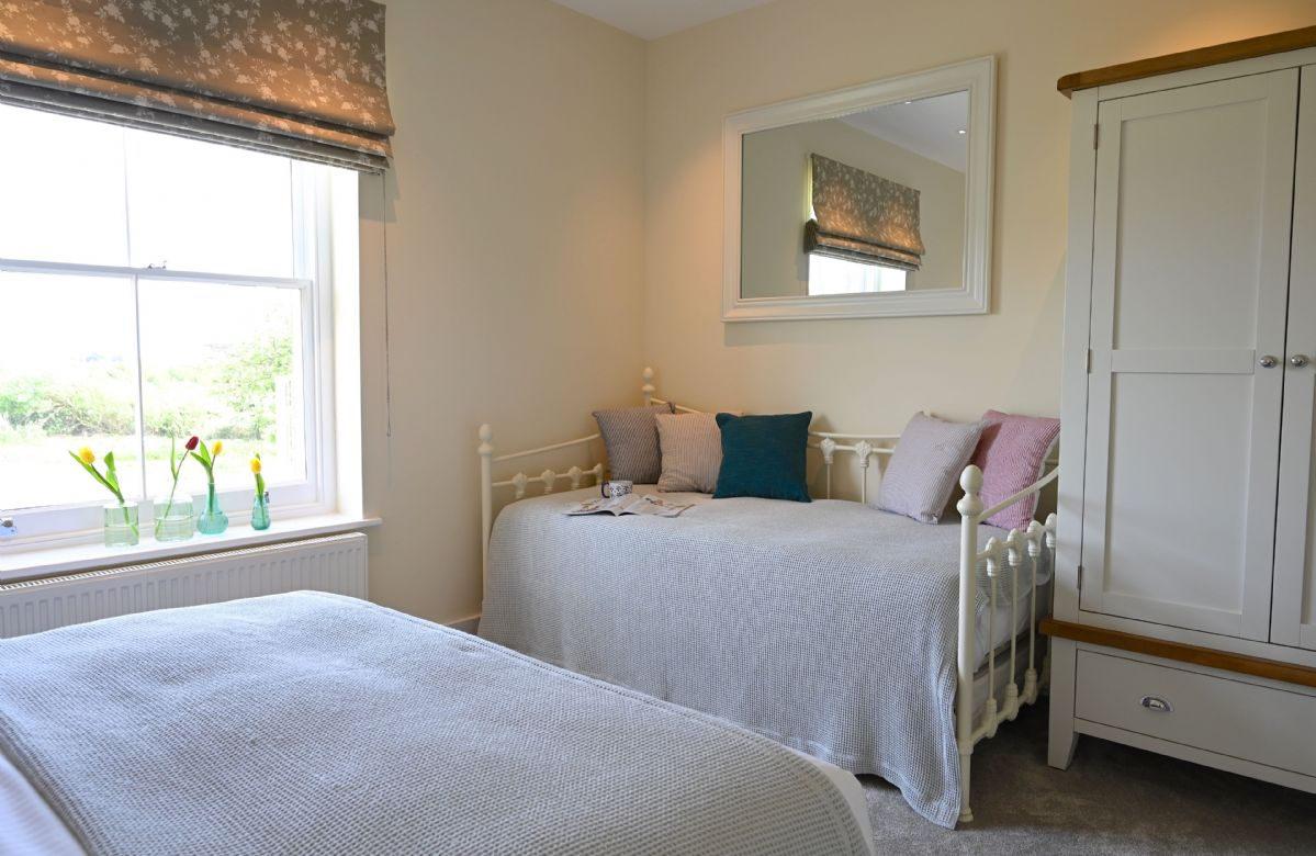 First floor:  Bedroom with super king size bed and single day bed