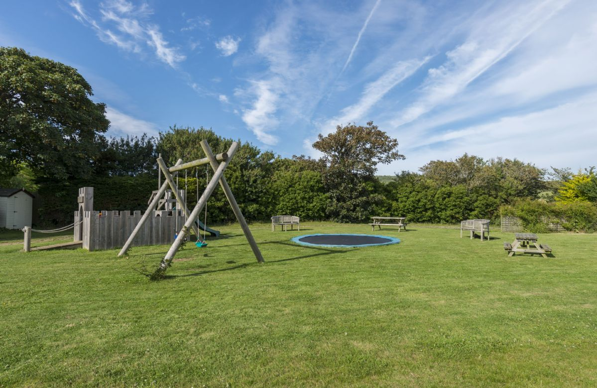 The playground at Brook Farmhouse Cottages