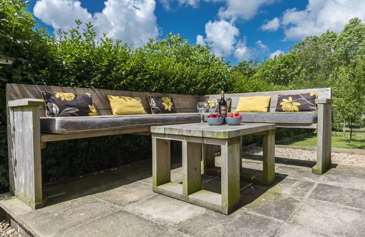 Pretty garden with garden furniture and barbecue