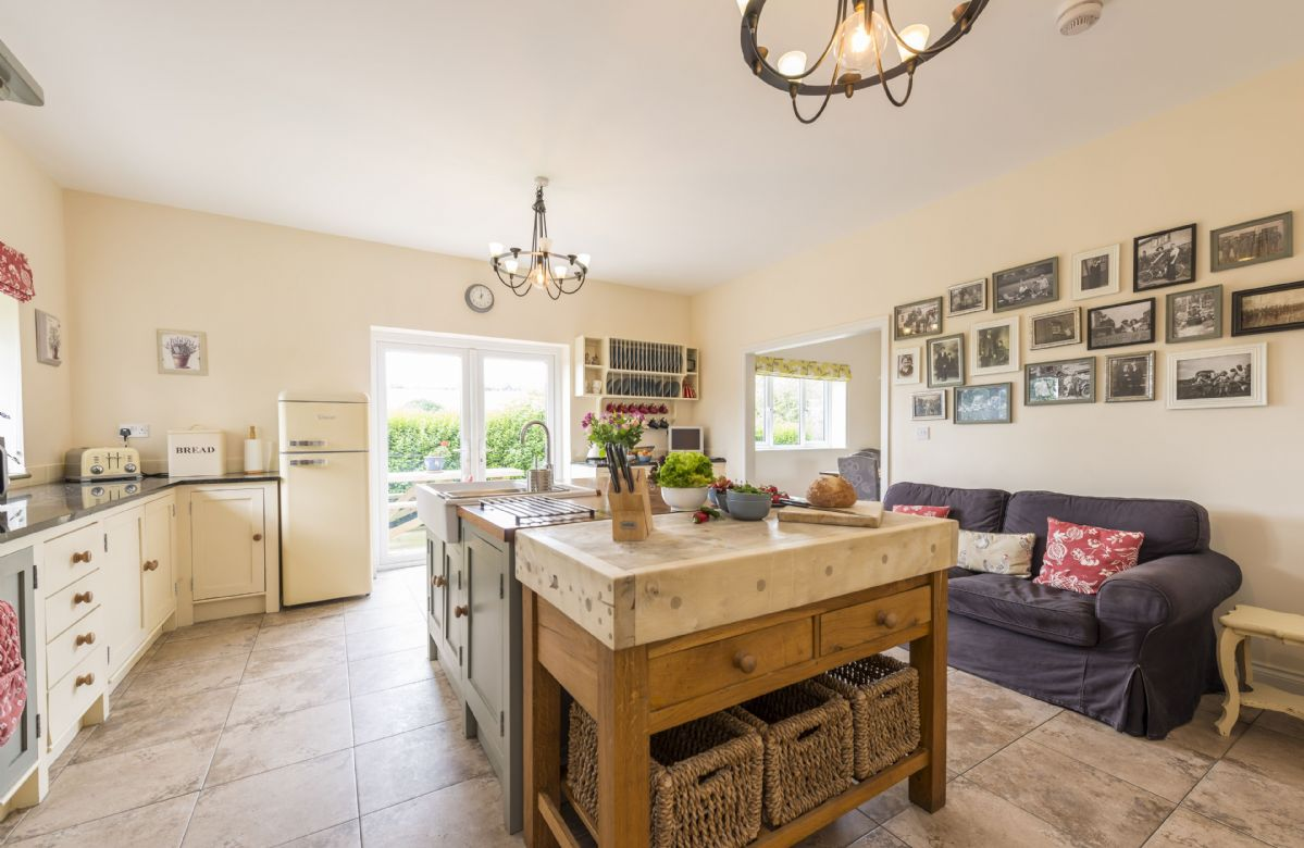 Ground floor: Sofa, granite worktops and double electric Aga in the kitchen