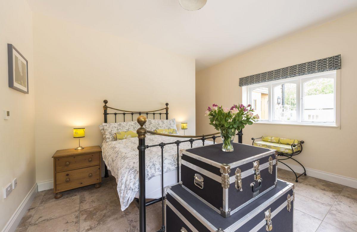 Ground floor: Bedroom with double bed and en-suite shower room