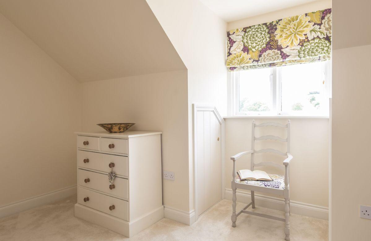 First floor: Bedroom with double bed and en-suite bathroom