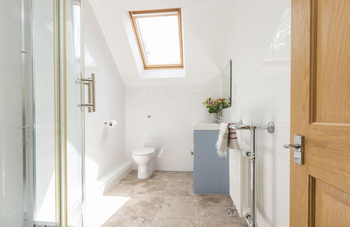 First floor: En-suite shower room with walk in shower enclosure
