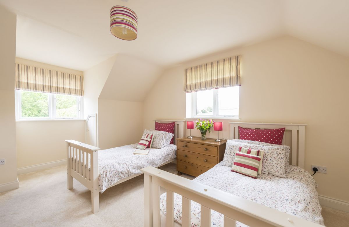 First floor: Bedroom with two single beds and en-suite shower room