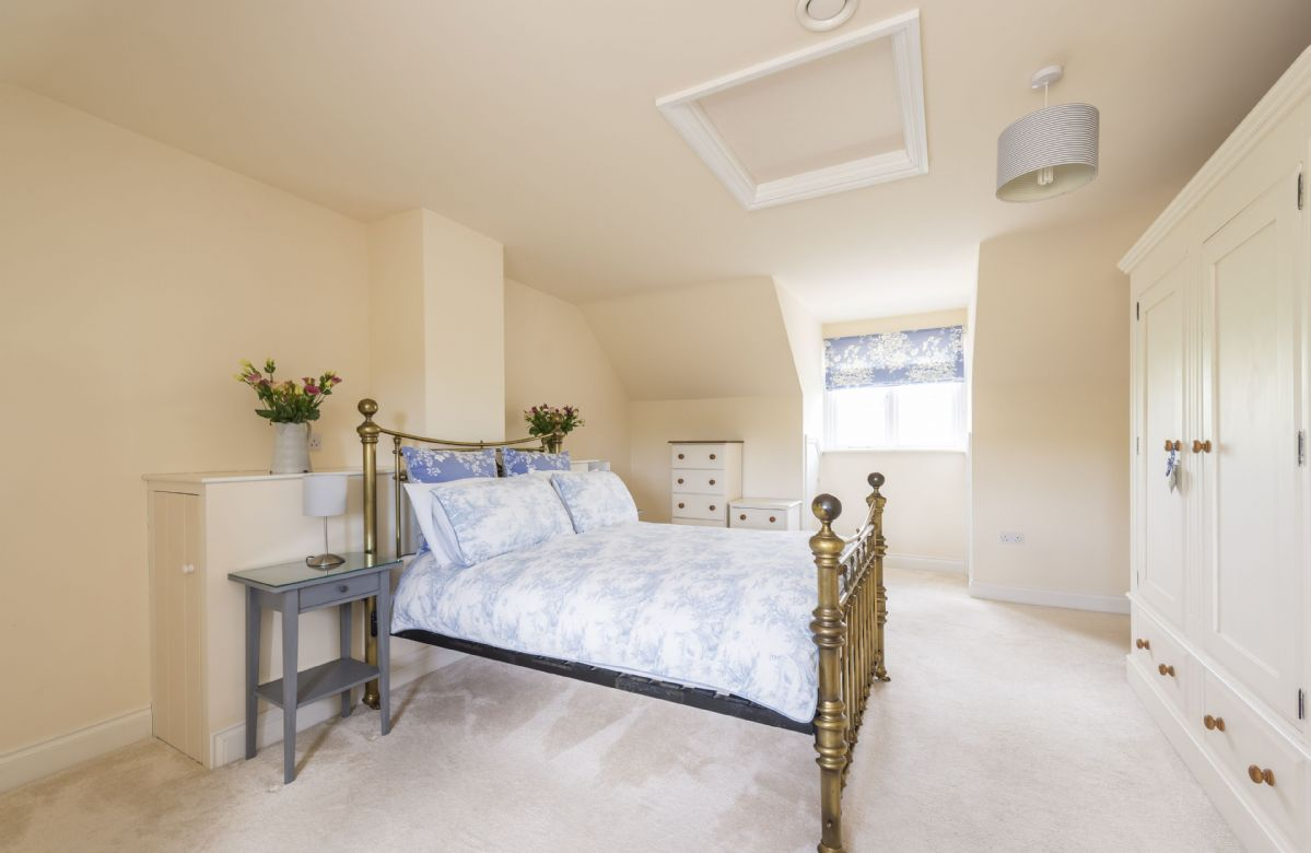 First floor: Bedroom with double bed and en-suite shower room