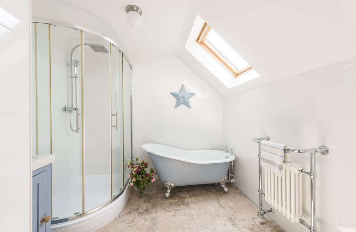 First floor: En-suite bathroom with walk in shower and separate roll top bath