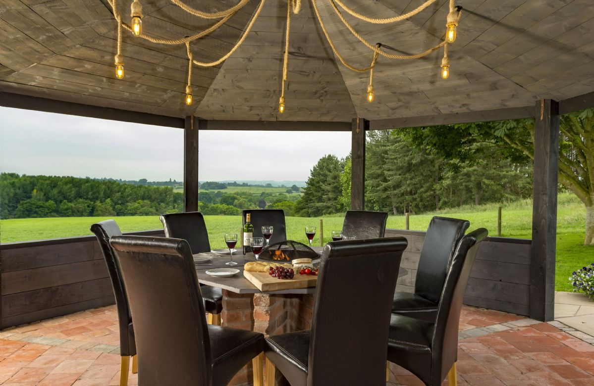 Gazebo with garden furniture and countryside views
