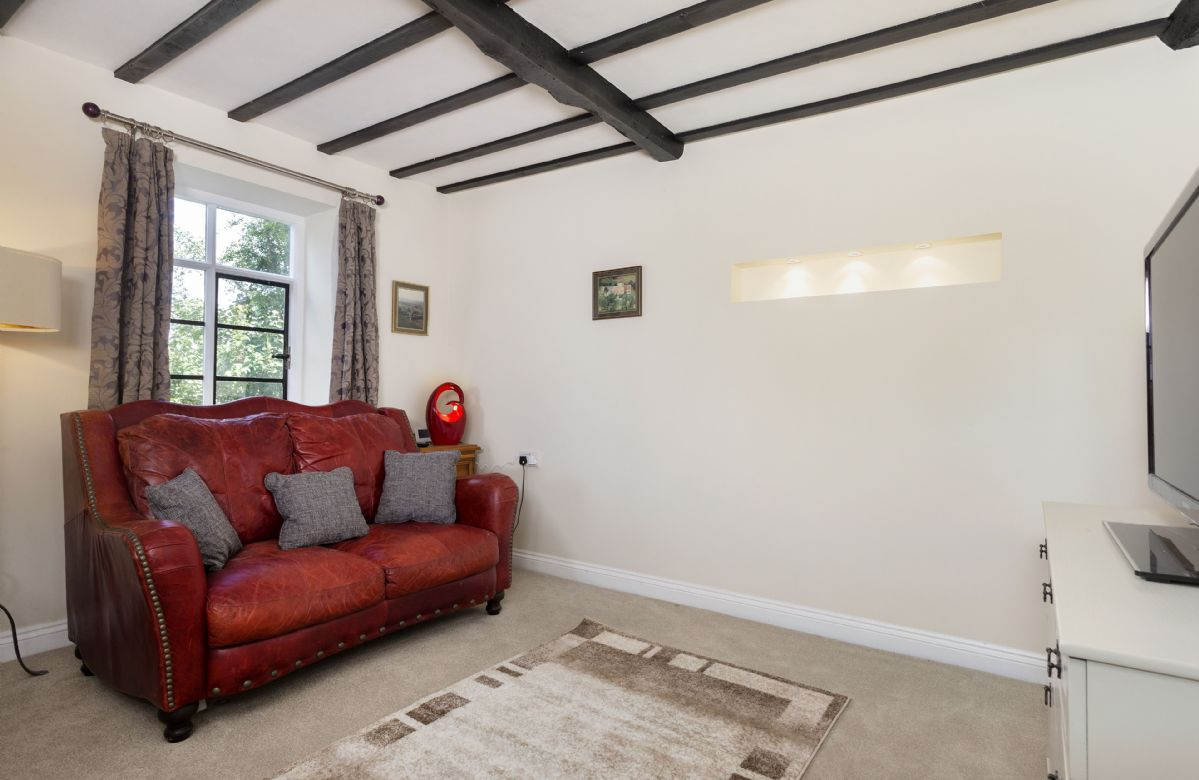 Ground floor: Small sitting room with sofa, bean bags and a smart television