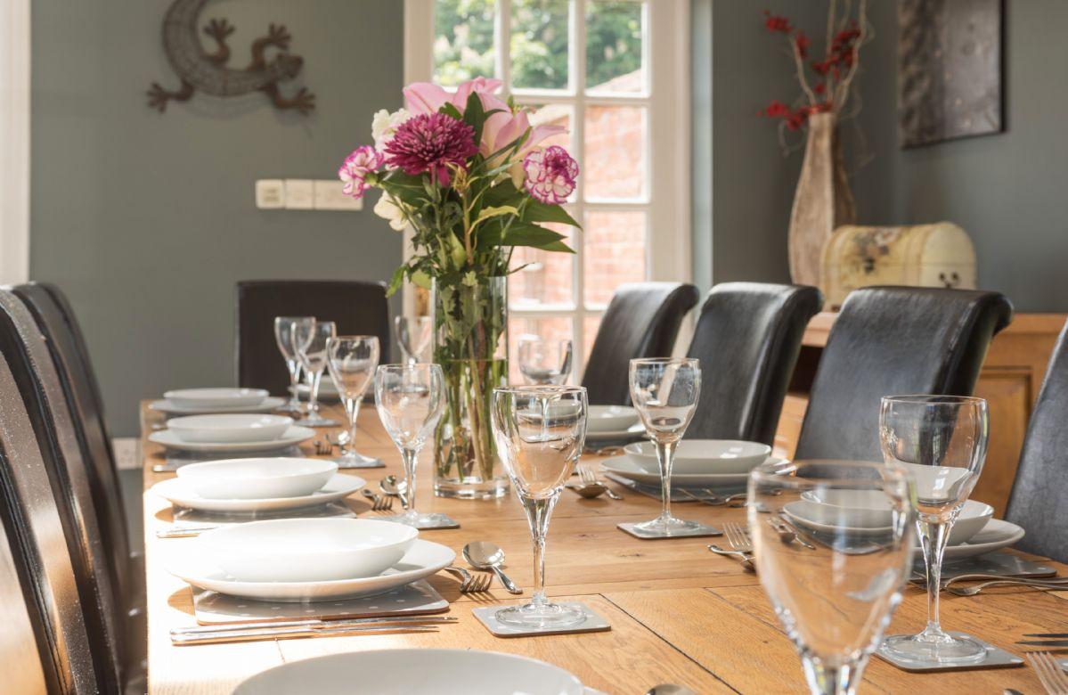 Ground floor: The elegant dining table seating twelve guests